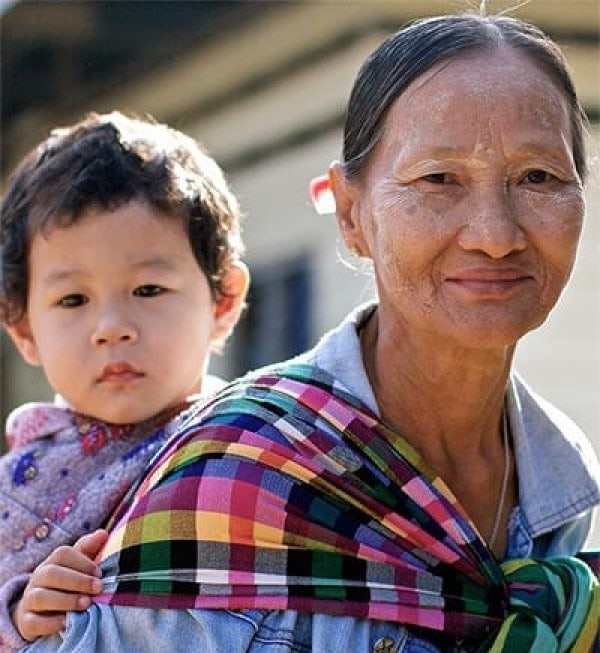 Photo of  Daw Ngwe Tein babysitting her grandchild, Blu Nay L'Paw featured in Roche Diagram healthcare publications. Blu's mother works as a medic in one of the field clinics of the Shoklo Malaria Research Unit in Mae Sot, Thailand.
